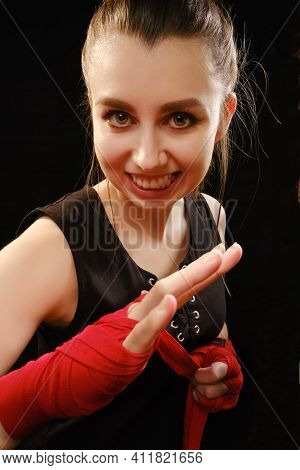 Muay Thai Female Boxer Wearing Strap On Wrist. Fitness Young Woman With Muscular Body Preparing For