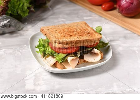 Sandwich With Ham And Fresh Salad On The Plate.