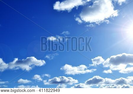Sky background, bright blue sky landscape, white clouds under bright sunlight.Blue sky,sky background,picturesque sky,vast blue sky landscape Sky landscape.Sky background.Dramatic blue sky background,scenic sky landscape,sky panoramic scene,sunny blue sky