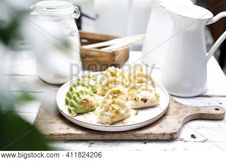 Dumplings, Pierogi With Chopped Fried Onion, On A Plate, In A Rustic Composition.