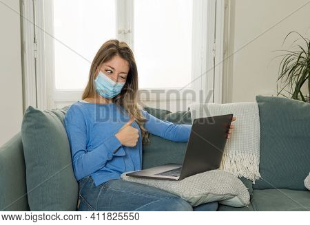 Happy Young Woman On Zoom Video Calling Family And Friends Using Laptop During Social Distancing