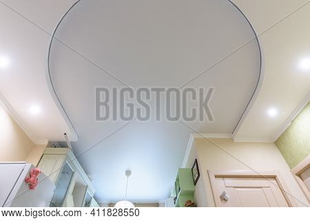 Two-level Oval Suspended Ceiling In The Interior Of The Living Room, The Lower Level Is Made Of Plas