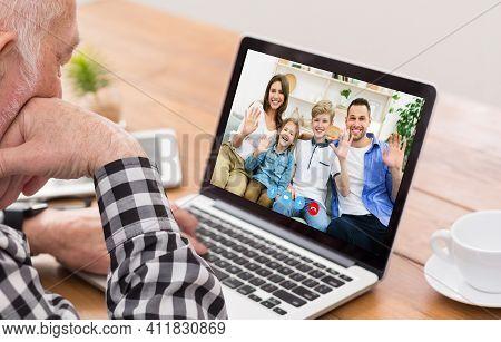Senior Man Communicating To His Family Online, Speaking To His Nears On Webcam. Elderly Male Using M