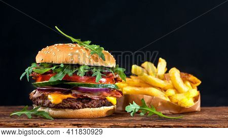 Hamburger On Black Background Tasty And Delicious Oily French Fries Finger Chips Fresh And Unhealthy