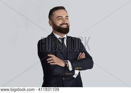 Happy Corporate Employee In Business Suit And Tie Crossing His Arms On Light Grey Background. Portra