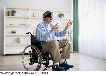 Happy Handicapped Senior Man In Wheelchair Using Vr Headset To Explore Augmented Reality At Home. Di