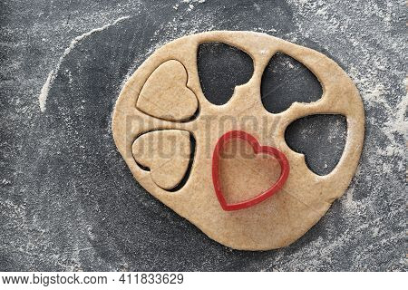 Process Of Making Heart-shaped Shortbread Cookies. Piece Of Dough And Cookie-cutteres