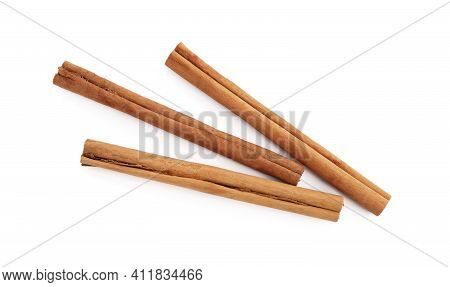 Aromatic Dry Cinnamon Sticks On White Background, Top View