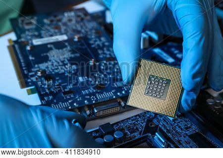 Technician Repairing Computer Motherboard At Table, Closeup. Electronic Device