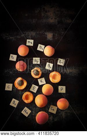 Apricots, Apricot Halves, Lettering With Vitamins. The Concept Of The Content Of Useful Substances I