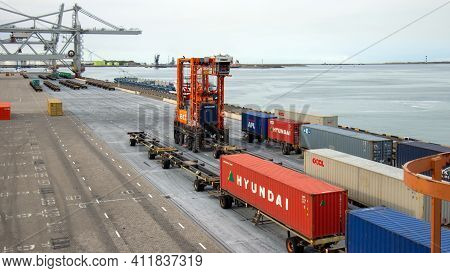 Straddle Carrier Moving A Maersk Container In The Shipping Terminal Of The Port Of Rotterdam, The Ne