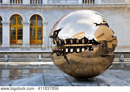 Dublin, Ireland - Feb 15, 2014: Abstract Spherical Metal Sculpture On A Courtyard Of Trinity College