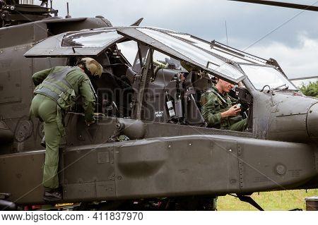 Gilze-rijen, Netherlands - Jun 20, 2014: Pilot And Gunner In An Ah-64 Apache Attack Helicopter.