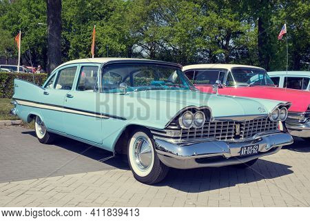 Den Bosch, The Netherlands - May 10, 2016: Parked 1959 Plymouth Belvedere Classic Car.