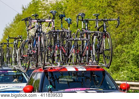 The Netherlands - May 7, 2016: Bicycles On A Car Following Cyclists During The Second Stage Of Giro