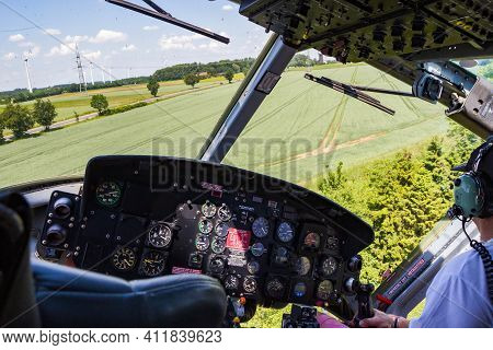Ahlen, Germany - Jun 5, 2016: Cockpit View Of A Bell Uh-1 Huey Helicopter In Flight.