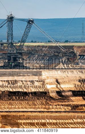 Large Bucket Wheel Excavator Mining Machine At Work In A Brown Coal Open Pit Mine