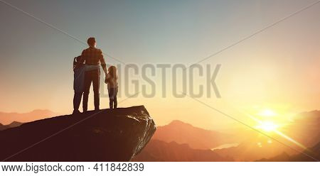 Happy family at sunset. Dad and children are having fun and enjoying journey.