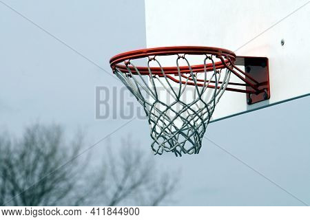 Backetball back board outdoor close up with sky