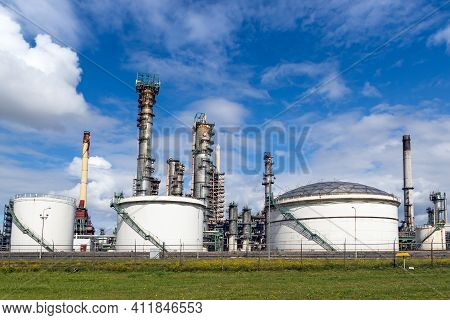 Industrial Pipelines And Silos At An Oil Refinery Plant.