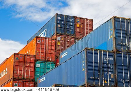 Shipping Containers Stacked At A Container Terminal In The Port Of Rotterdam. The Netherlands - Sept