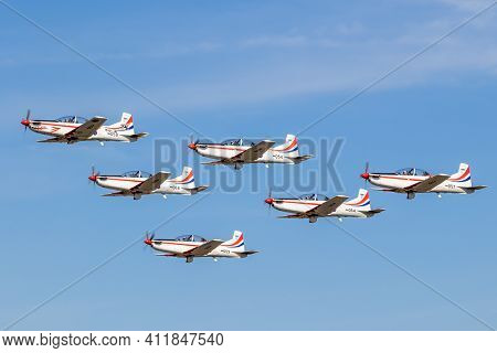 Croatian Air Force Pilatus Pc-9 Trainer Planes In Formation Flight Over Kleine-brogel Airbase. Belgi