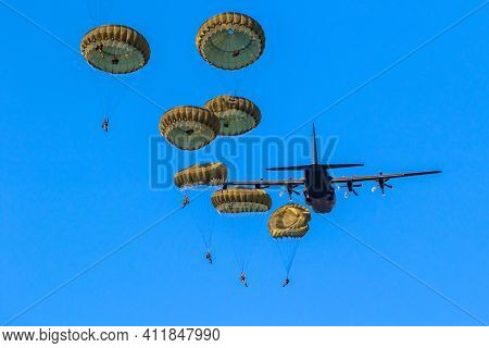Military Parachutist Paratroopers Parachute Jumping Out Of A Air Force Planes On A Clear Blue Sky Da