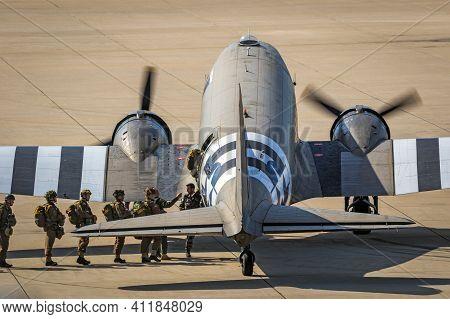 Paratroopers Entering A Douglas C-47 Skytrain Dakota Plane For A Jump At The Market Garden Memorial.