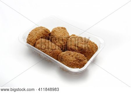Fried Chicken Kievs, De Volaille, Poultry Cutlets On A Plastic, Transparent Food Tray, Isolated On W