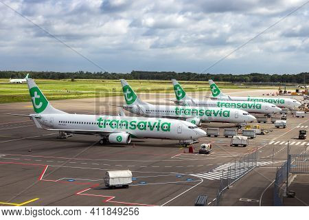 Transavia Low-cost Airline Passenger Planes On The Tarmac Of Eindhoven Airport. The Netherlands - Ju