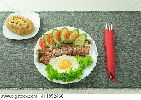 Fried Eggs With Bacon And Fresh Vegetables. Scrambled Eggs With Bacon And Cheese. Omelet With Vegeta