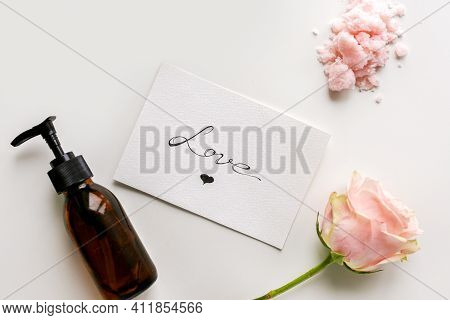 Body Care Cosmetics. Body Scrub. Bottle For Cosmetics. Love Lettering. Cosmetic Bottle. Rose With A