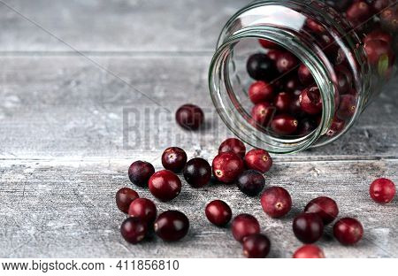 Jar And Cranberries. Selective Focus On Cranberries And Jar Sides. Close Up