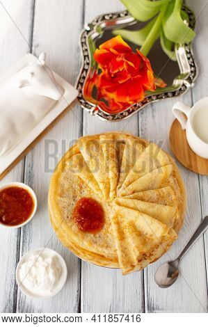 Pancakes With Jam, Breakfast, Flower, Spring, Womans Day. Traditional Russian Blini On White Wooden