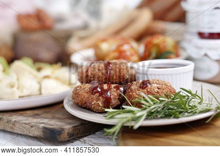 Close-up Of Fried Chicken Kievs, Poultry Cutlets On A White Plate, On A Wood Cutting Board. De Volai