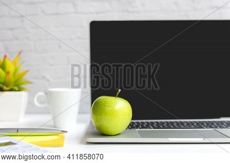 Healthy Snack With Working In Office.  Green Apple With Laptop On White Dress Working.  Healthy Life