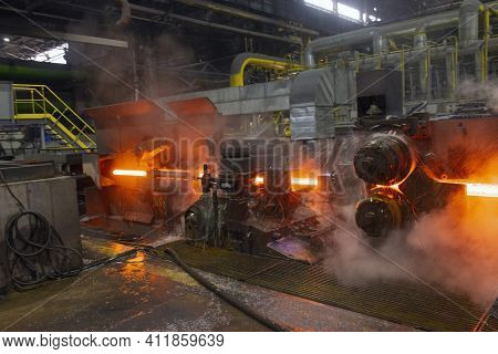 Hot Steel On Conveyor In A Steel Mill. Hot Rolled Rebar