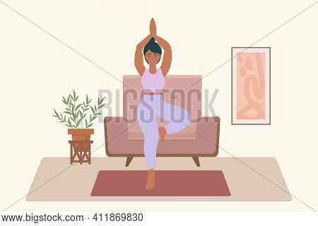 Yoga At Home. A Woman Does Yoga In Her Apartment. Boha Apartment Is Ideal For Yoga. A Beautiful Isol