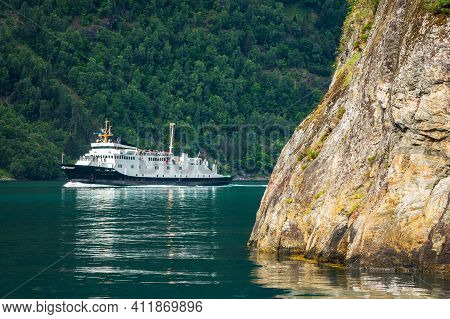 Ferryboat On The Geirangerfjord With Mountains In Norway.