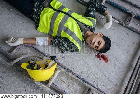 Accident Builder Fall Scaffolding To The Floor. Safety First And Accident At Work Concept. Employee