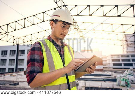 Asian Man Engineer Contractor In Construction Site Work During Inspection For Estimate Price For Ren