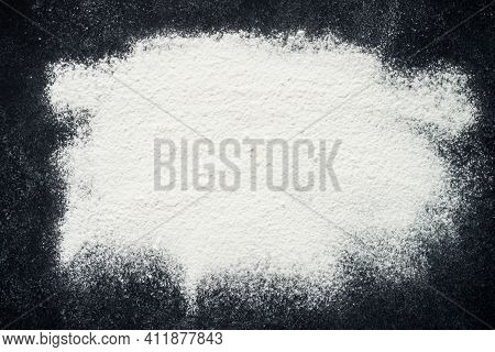 Baking Background. Sprinkled Flour On Black Background, Top View With Copy Space.