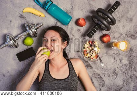 Healthy Asian Woman Eating Green Apple She Smiling In Sportswear Lying On The Floor With Exercise Eq