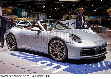 Porsche 911 Carrera S Cabriolet Sports Car At The 89th Geneva International Motor Show. Geneva, Swit