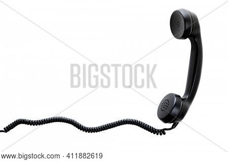 Receiver on spiral cord of vintage telephone isolated on white background