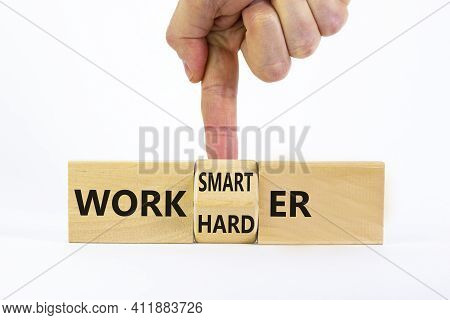 Work Harder Or Smarter Symbol. Businessman Turns Wooden Block And Changes Words 'work Harder' To 'wo