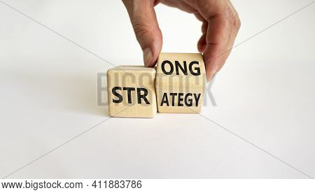 Strong Strategy Symbol. Businessman Turns A Wooden Cube With Words 'strong Strategy'. Beautiful Whit