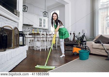 Young Attractive Cheerful Brunette Woman, Professional Worker Of Cleaning Service, Having Fun While