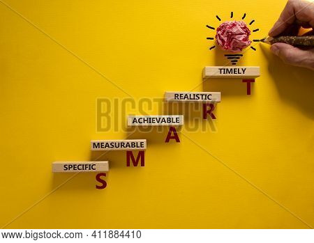 Business And Smart Symbol. Businessman Hand. Wooden Blocks With Words 'smart, Specific Measurable Ac