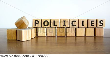 Policies Symbol. Concept Word 'policies' On Wooden Cubes On A Beautiful Wooden Table, White Backgrou